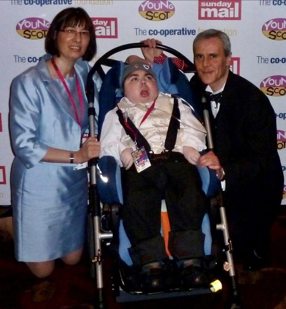 Photo of Adam Bojelian with his parents